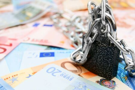 The lock, chain and money  Stock Photo - 14024536
