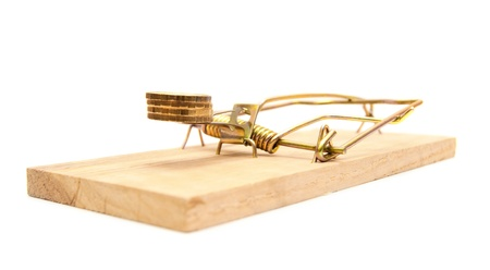 mouse trap: Gold coins in a mousetrap. On a white background.