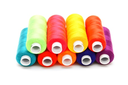 Multi-coloured threads. On a white background.