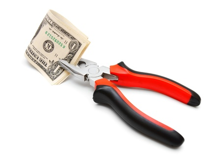 Pliers and money. On a white background. photo