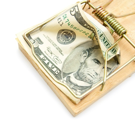 Money and mousetrap. On a white background. photo