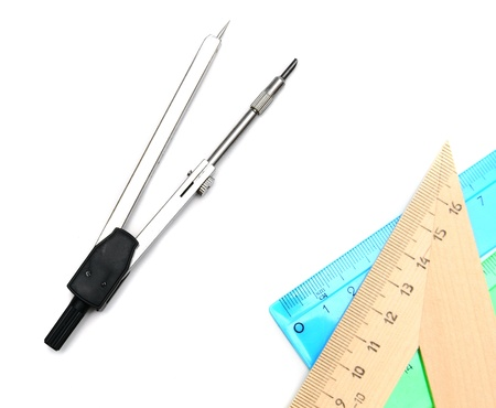 Compasses and rulers. On a white background.