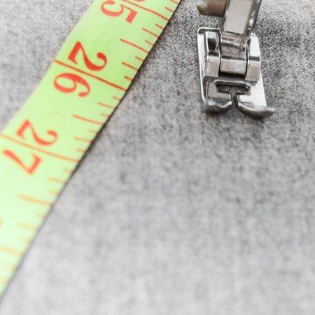 The sewing machine and measuring tape. photo