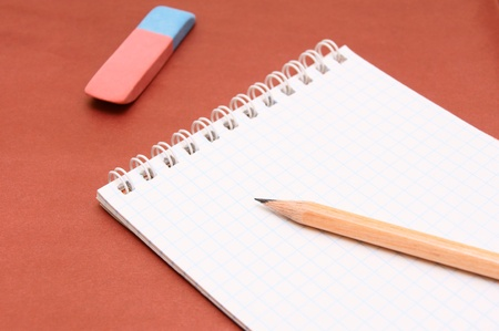 A notebook and pencil . photo