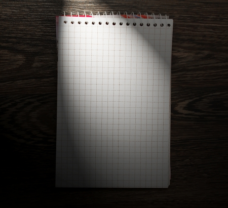Notebook on a wooden background. Stock Photo - 14755274