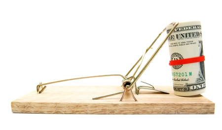 Money in a mousetrap. On a white background. photo