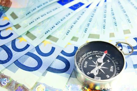 pioneering: Money and compass . . Stock Photo