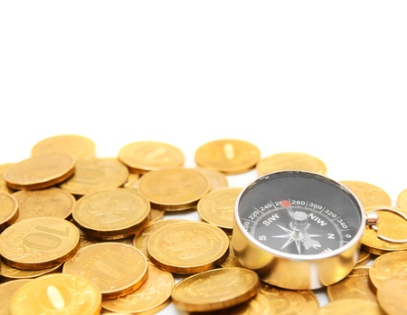 Gold coins and compass. On a white background. Stock Photo - 14755268