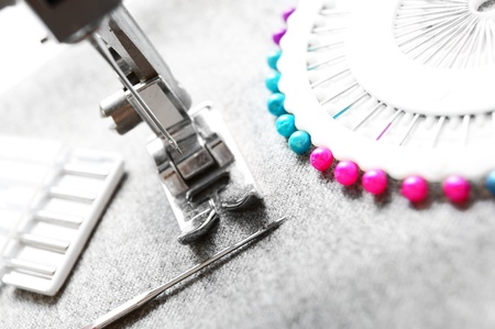 The sewing machine and needles. photo