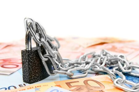 The lock, chain and money. On a white background. photo