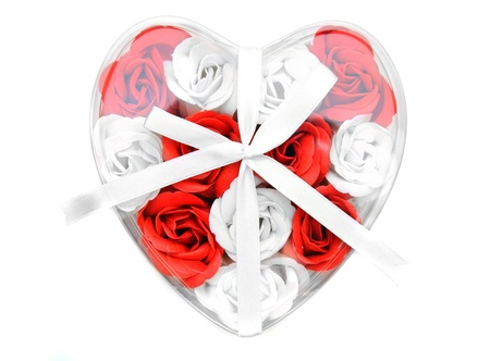 Box in the form of heart with roses. On a white background. photo