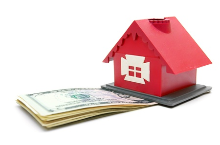 The house and money. On a white background. photo