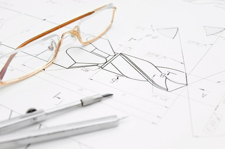 bluelines: Glasses and compasses on the drawing.