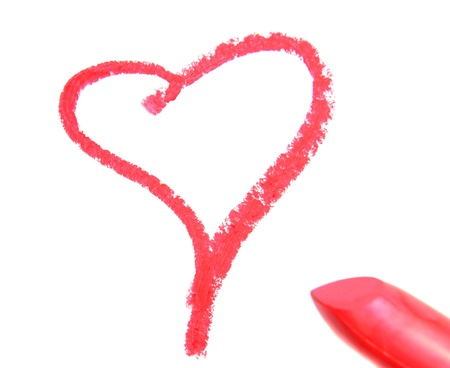 Sign on heart from lipstick. On a white background.