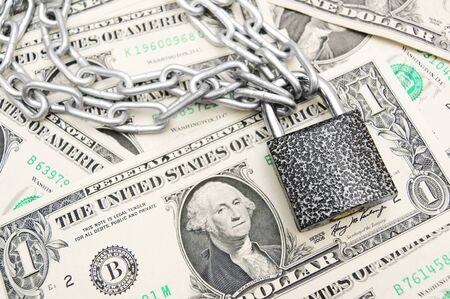 The lock, chain and money. Stock Photo - 14933094