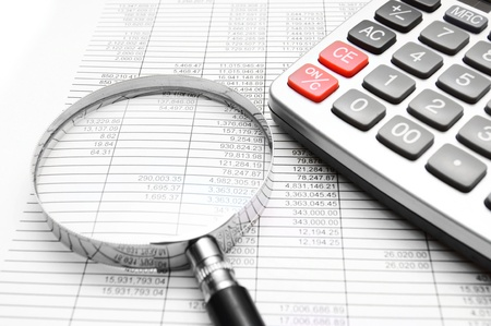 The calculator, magnifier on documents. Stock Photo