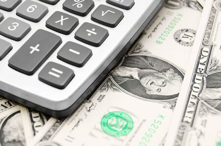 dwelling mound: The calculator and money . Stock Photo