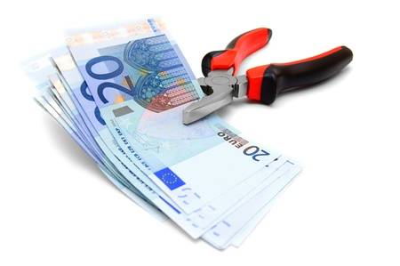 Money and pliers. On a white background. photo