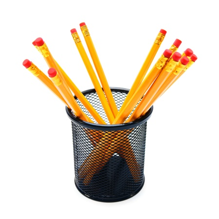 Pencils in a basket. On a white background. photo