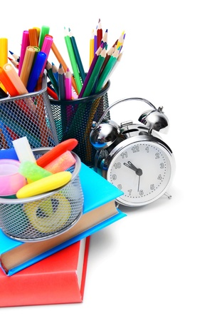 School accessories, books and alarm clock. On a white background. photo