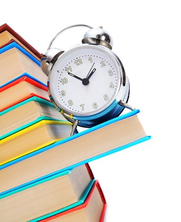 Back to school. An alarm clock and books. photo