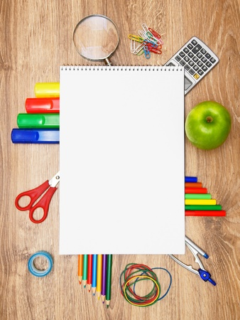 Back to school. School accessories on a wooden background. Stock Photo - 15498376