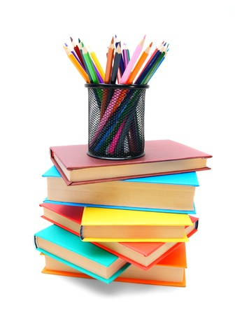 Multi-coloured books and basket with pencils. On a white background. photo