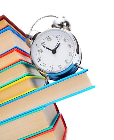 학교로 돌아가다. 알람 시계 및 책입니다.