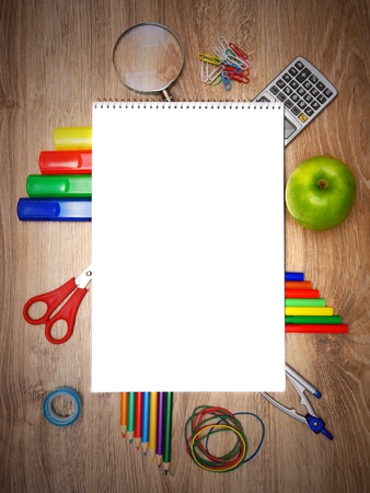 rubber sheet: Back to school. School accessories on a wooden background.