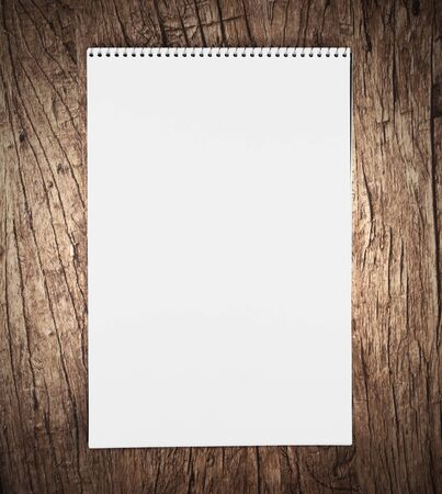 Notebook on a wooden background. Stock Photo