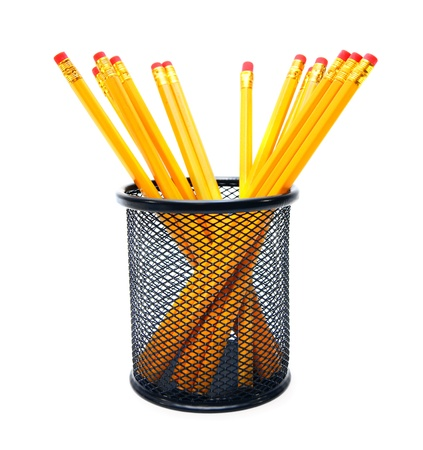 Pencils in a basket. On white background. photo