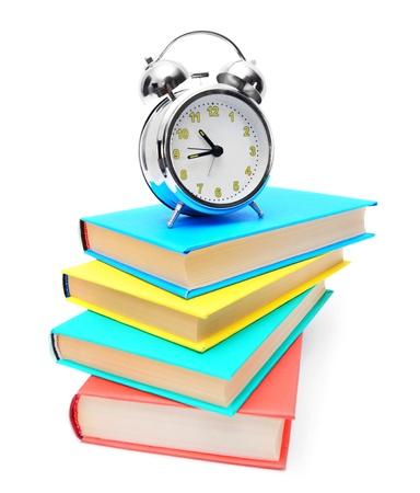 alarm clock and books .