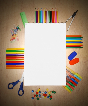 School accessories on a wooden background. photo