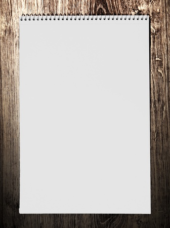 Notebook on a wooden background. photo