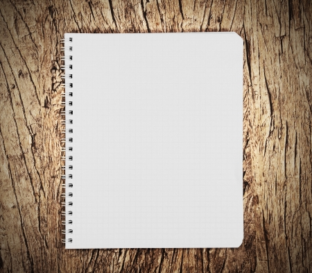Notebook on a wooden background  photo