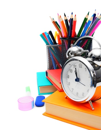 School    Books and school tools with an alarm clock  photo