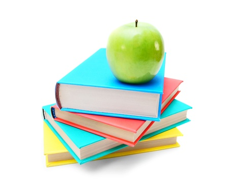 Books and a green apple  On white background  photo