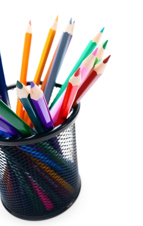 Multi - coloured pencils in a basket  photo