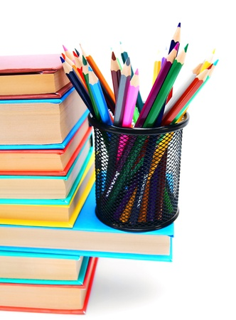 Multi - coloured books and basket with a pencils  photo