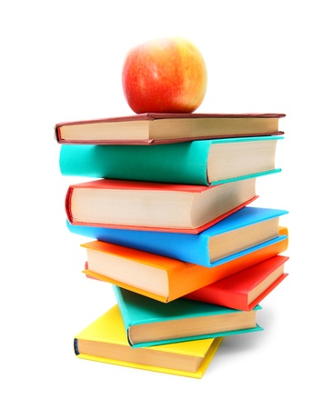 Books and a red apple  On white background  photo