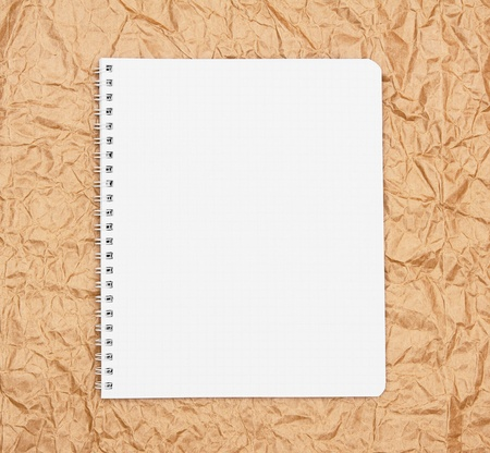 Notebook on the rumpled paper Stock Photo - 15266769
