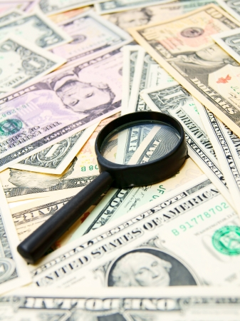Money  dollars  and magnifier  Stock Photo - 17224395