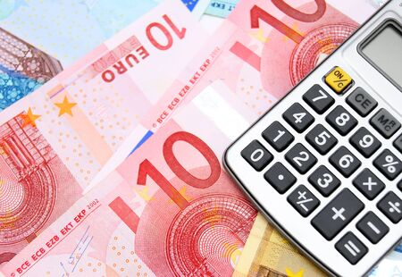 Money and the calculator Stock Photo - 17237083