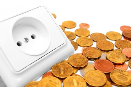 current account: The socket electric and gold coins  Stock Photo