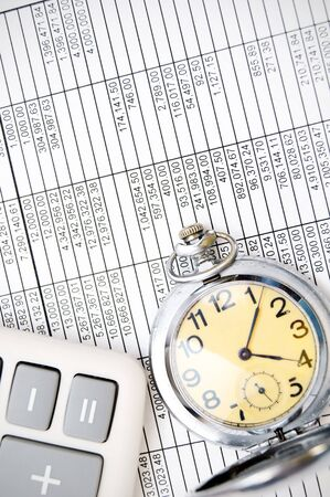 Watch and the calculator  On documents Stock Photo - 17237048