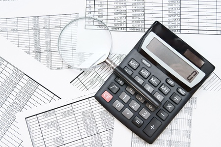 The calculator and magnifier on documents  Stock Photo