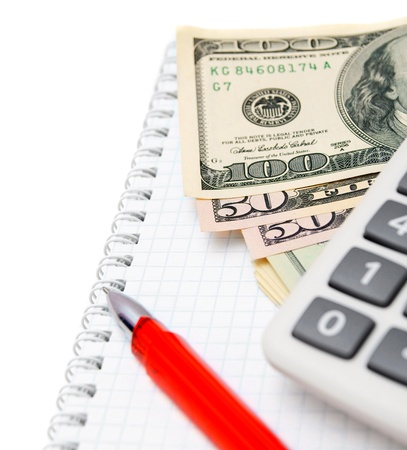 Red pen, the calculator and money on a notebook Stock Photo - 17233555
