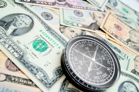 The compass and is a lot of money. Dollars and a compass. Stock Photo - 17237017