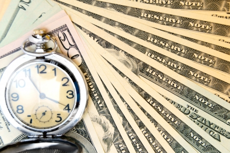 Watch and money. A Dollars. Stock Photo - 17237110