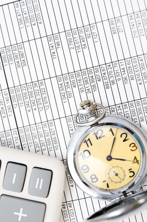 Watch and the calculator. On documents. Stock Photo - 17237045